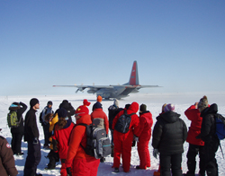 Crew waiting for plane to land on the ice