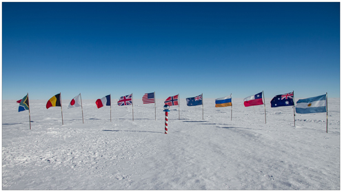 Flags from the 12 countries that participate in the experiment is standing in the ice
