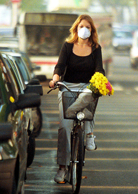 Woman cycling with face mask