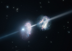 Two early galaxies with a gamma ray burst traveling from one to the other after the initial explosion